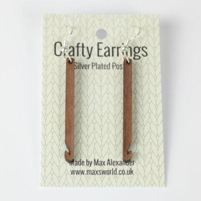 Wood crochet hook earrings on a backing card. Text reads Crafty Earrings, Silver plated hooks. Made by Max Alexander