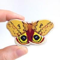automeris-io-moth-brooch-hand