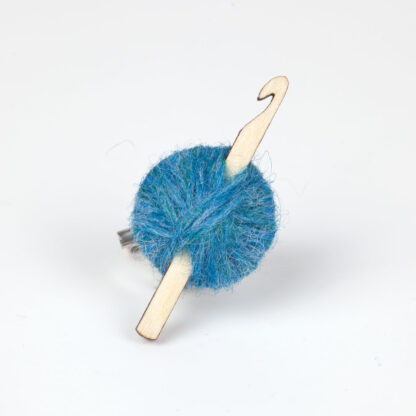 blueball of wool with crochet hook on a white background