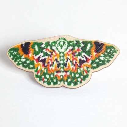 wooden pin with a green, orange and yellow printed on it.
