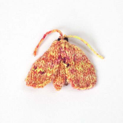 Knitted pink and yellow moth brooch