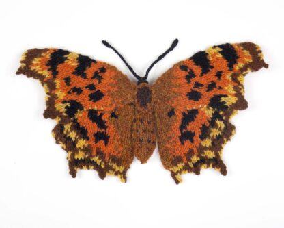 Knitted orange and brown butterfly with scalloped wings