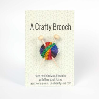 knitting brooch on backing card