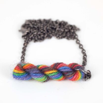 mini skein necklace made with pride rainbow yarn