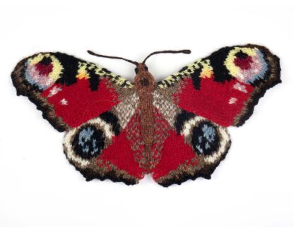 red butterfly with brightly coloured eyespots on all 4 wings