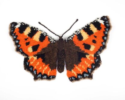 Knitted orange and brown butterfly