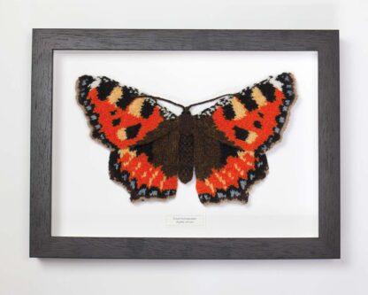 framed knitted orange butterfly