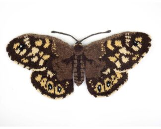 Knitted brown and bei.ge butterfly