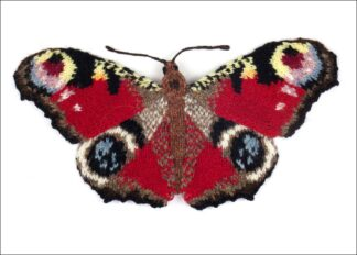 knitted red butterfly with dramatic eye spots on a white background