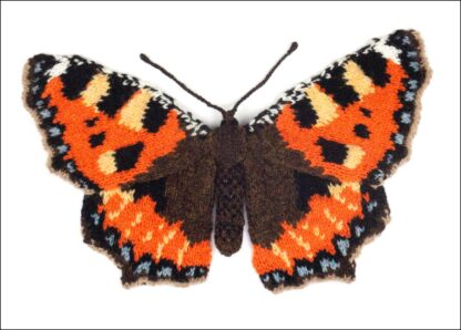 knitted orange and brown butterfly on a white background